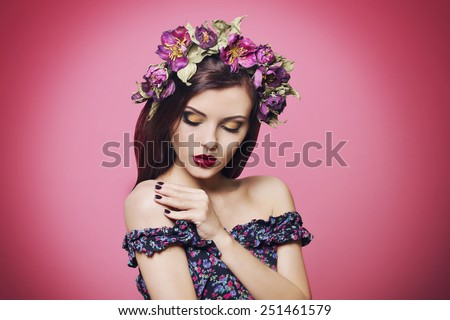 Portrait of beautiful girl with floral crown and bright makeup - stock photo