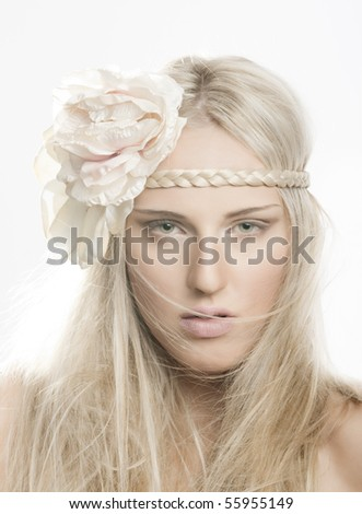portrait of beautiful girl with flower in her hair - stock photo