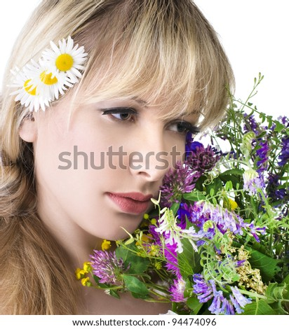 Portrait of beautiful girl with flowers - stock photo