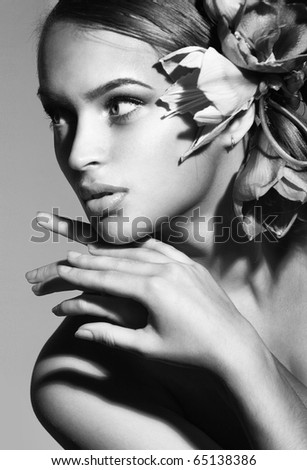 Portrait of beautiful girl with flowers in her hair