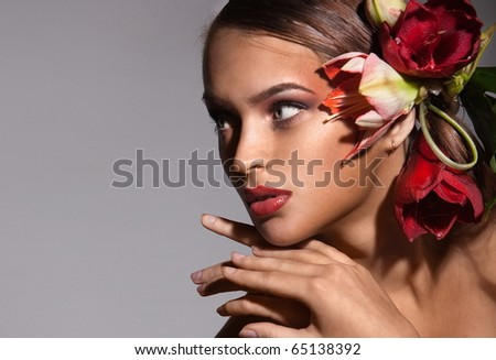 Portrait of beautiful girl with flowers in her hair - stock photo
