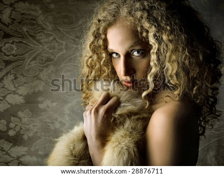 portrait of beautiful girl with fur - stock photo