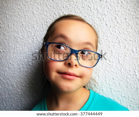 Portrait of beautiful girl with glasses - stock photo