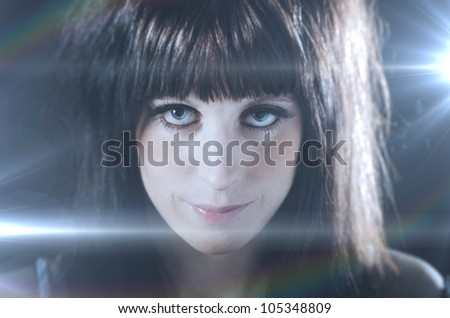 Portrait of beautiful girl with lens flares from spotlights behind her