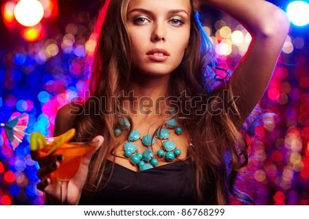 Portrait of beautiful girl with martini glass - stock photo
