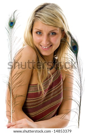 Portrait of beautiful girl with peacock a feather. Isolated over white background