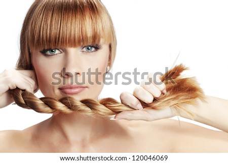Portrait of beautiful girl with perfect long shiny blond hair studio shot on white background - stock photo