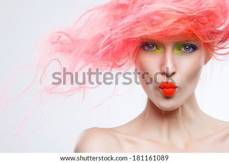 Portrait of beautiful girl with pink hair, kisses - stock photo