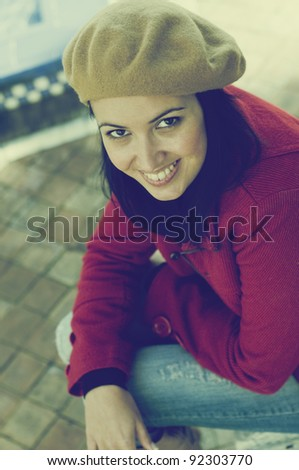Portrait of beautiful girl with red coat and beret