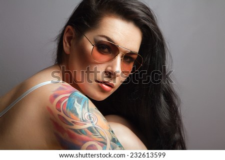 portrait of beautiful girl with tattoos. tattoos - stock photo