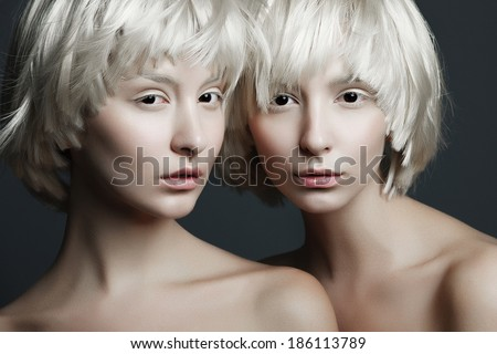Portrait of beautiful girls twins with clean skin - stock photo
