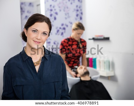 Portrait Of Beautiful Hairstylist In Salon - stock photo