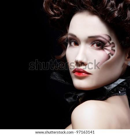 portrait of beautiful halloween woman vampire baroque aristocrat over black background - stock photo