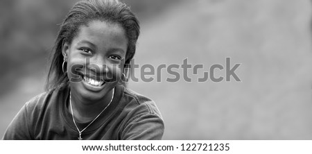 Portrait of Beautiful happy African-American girl  with space for add in black and white - stock photo