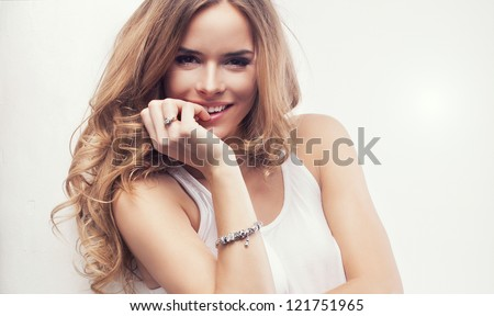 Portrait of beautiful happy blonde woman - stock photo