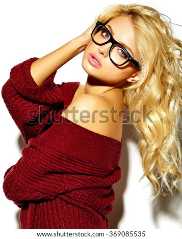 portrait of beautiful happy cute blonde woman girl in casual hipster warm winter clothes, in red sweater in glasses - stock photo