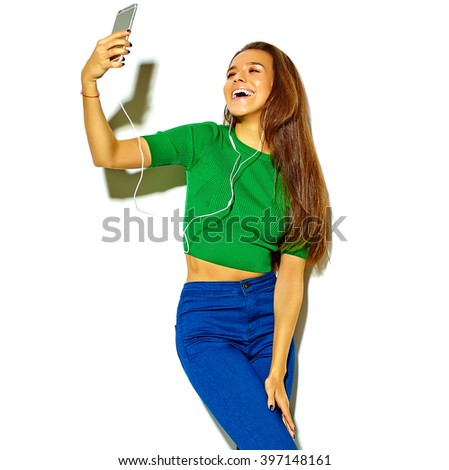 portrait of beautiful happy cute smiling brunette woman girl in casual green hipster summer clothes with no makeup isolated on white,take a selfie - stock photo