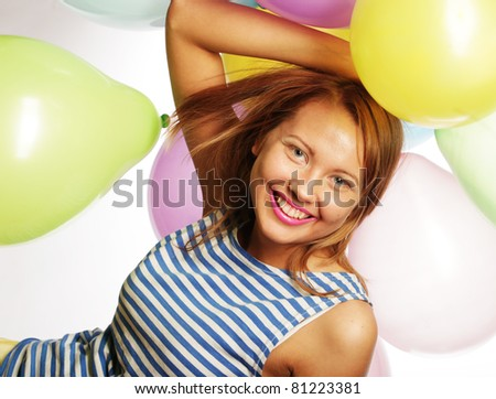 portrait of beautiful happy girl with balloons - stock photo