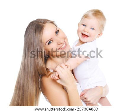 Portrait of beautiful happy mother and her cute baby - stock photo