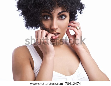 Portrait of Beautiful happy mulatto girl with smooth skin and dark curly hair, isolated. - stock photo