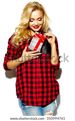 portrait of beautiful happy sweet smiling blonde woman girl holding in her hands Christmas gift box in casual red hipster winter clothes - stock photo