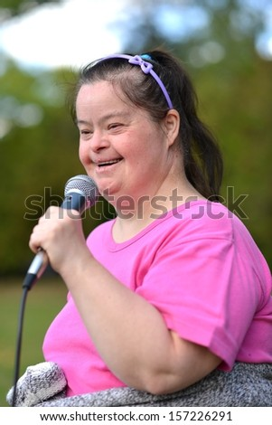 Portrait of beautiful happy woman with Down syndrome - stock photo