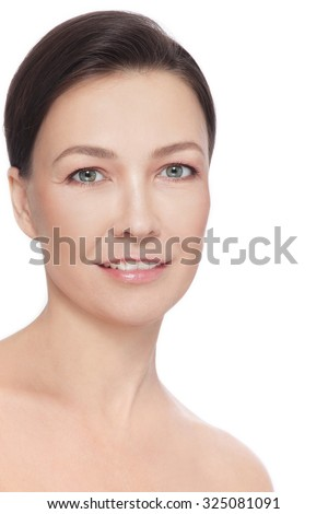 Portrait of beautiful healthy happy smiling mature woman over white background - stock photo