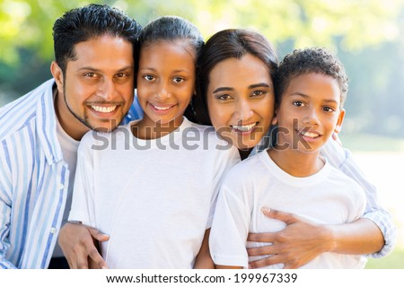 portrait of beautiful indian family outdoors - stock photo