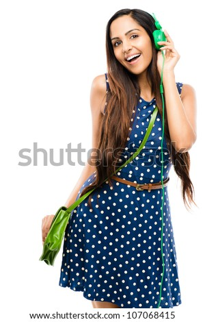 Portrait of beautiful Indian woman fashion model with headphones on white background