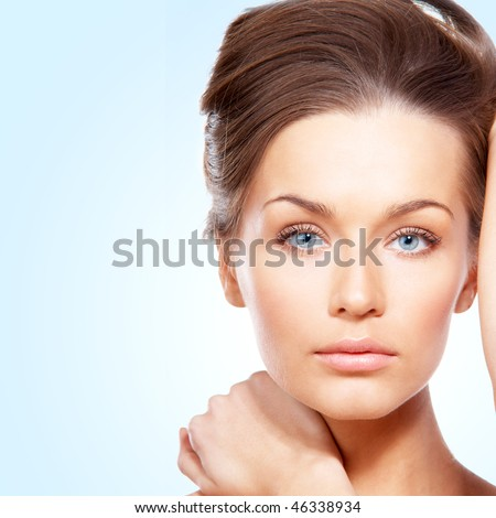Portrait of beautiful lady on blue - stock photo
