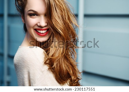 Portrait of beautiful laughing girl lifestyle - stock photo