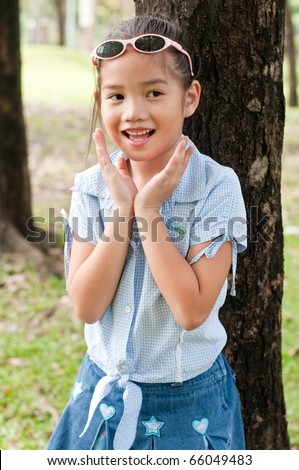 Portrait of beautiful little asian girl in the park, Thailand.