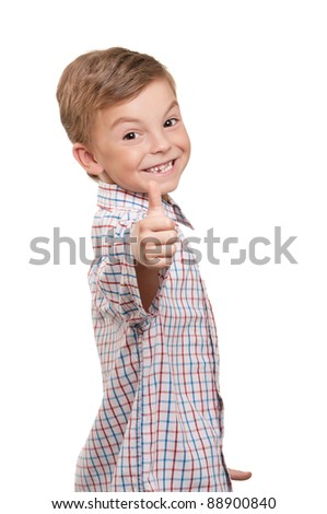 Portrait of beautiful little boy giving you thumbs up over white background - stock photo