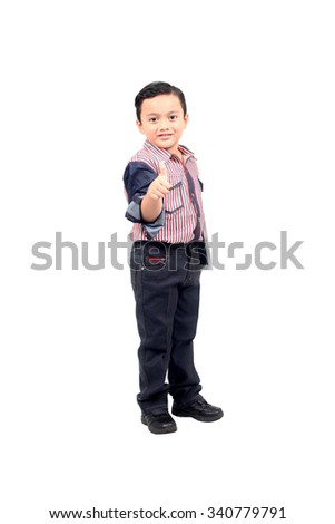 Portrait of beautiful little boy giving you thumbs up over white background and gadget - stock photo