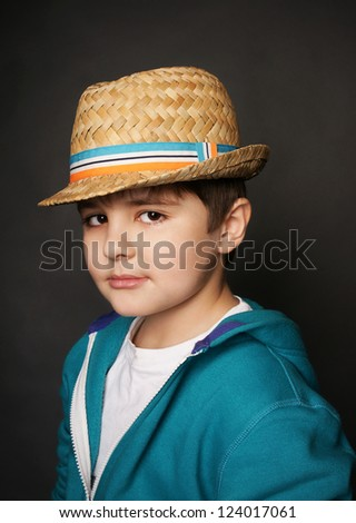 Portrait of beautiful little boy in stylish hat, studio shot - stock photo