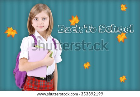 Portrait of beautiful little girl in school uniform with backpack on blue background - stock photo