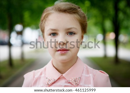 Portrait of beautiful little girl in the Park