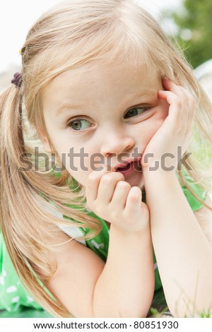 Portrait of beautiful little girl in the park - stock photo