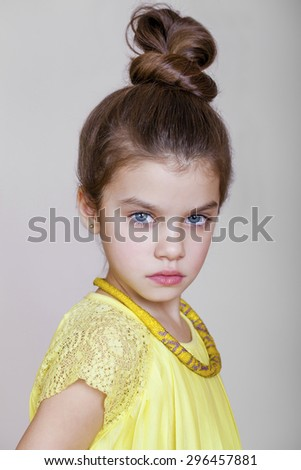 Portrait of beautiful little girl, studio on white background  - stock photo