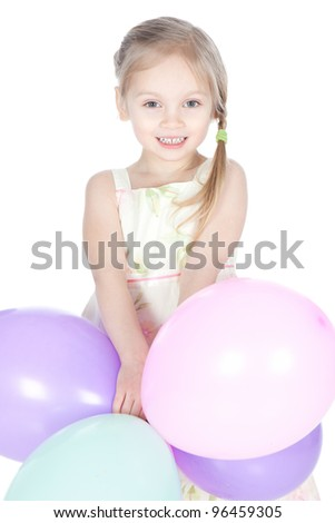 Portrait of beautiful little girl with colorful balloons over white - stock photo