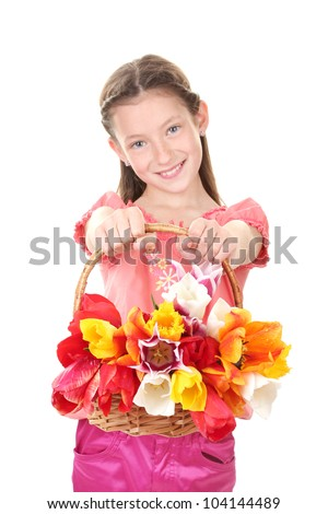 Portrait of beautiful little girl with tulips in basket isolated on white