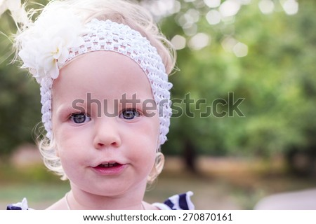 Portrait of beautiful little girls on the nature. - stock photo