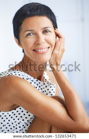 Portrait of beautiful middle aged woman - stock photo