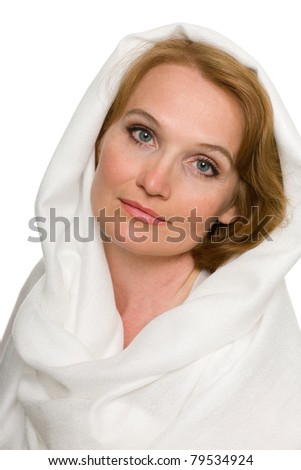 Portrait of beautiful middle aged woman in a white headscarf. - stock photo