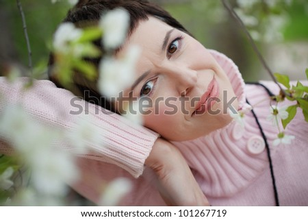 Portrait of beautiful middle aged woman in spring - stock photo