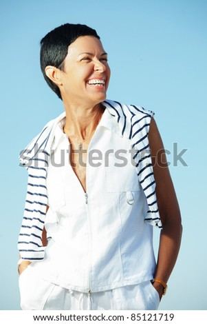 Portrait of beautiful middle aged woman outdoors - stock photo