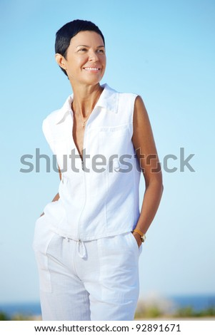 Portrait of beautiful middle aged woman outdoors