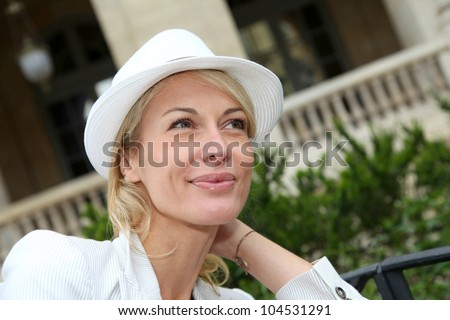 Portrait of beautiful middle-aged woman wearing hat - stock photo