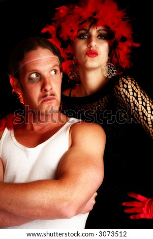 Portrait of beautiful Middle Eastern woman in costume with man dressed as thug. - stock photo