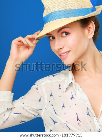 Portrait of beautiful model in hat ,isolated on blue background